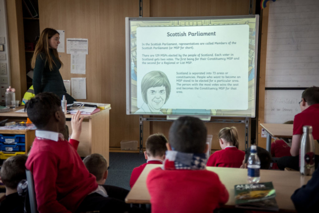 Students from a Glasgow primary school attend a course on democracy